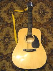 Акустическую гитару
